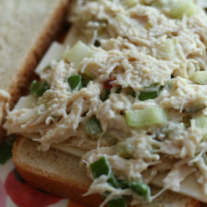 Dilly Chicken Salad on Sourdough bread with a slice of Swiss cheese.